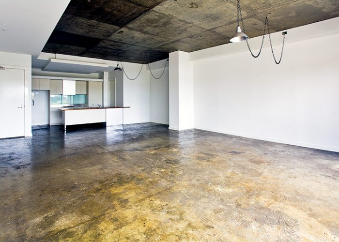 Industrial style apartment kitchen & dining room before property styling