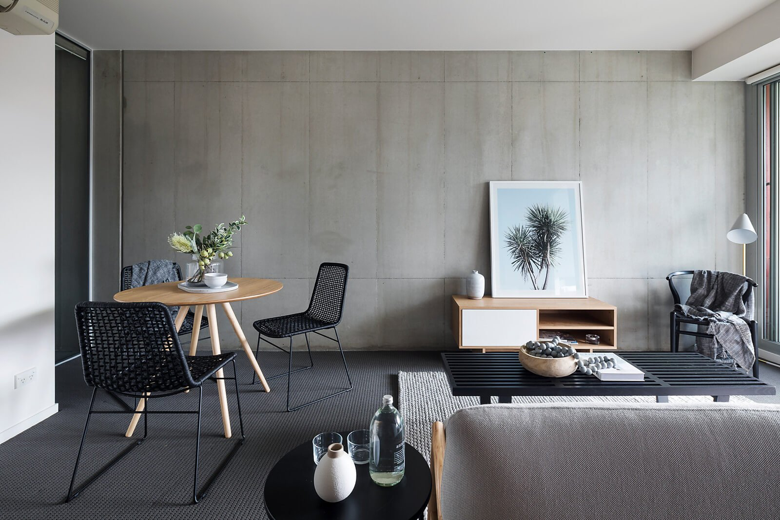 Black on gray concrete apartment living room, an example of property styling by The Urbane Property Stylist