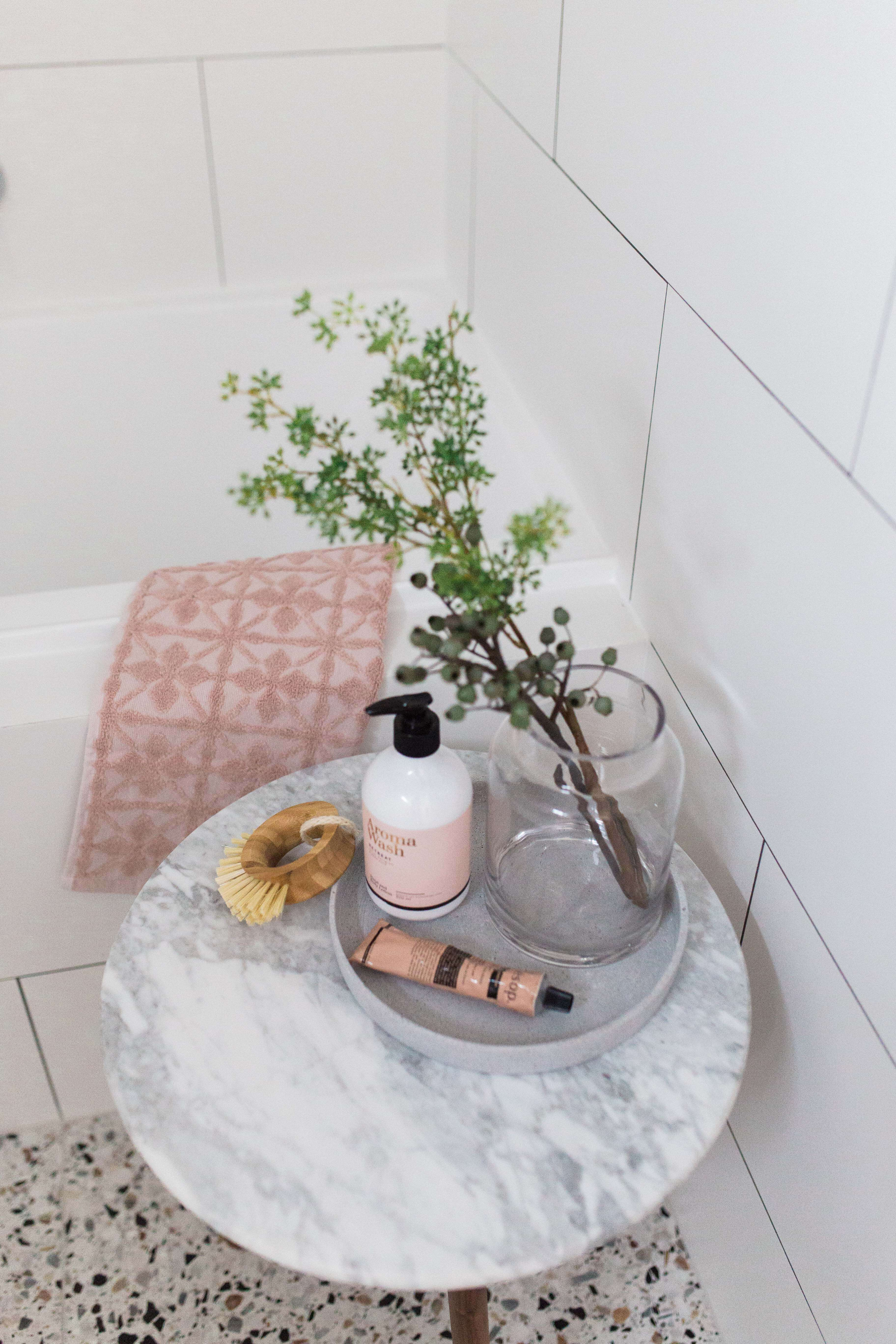 Marble bath side table with bathroom product