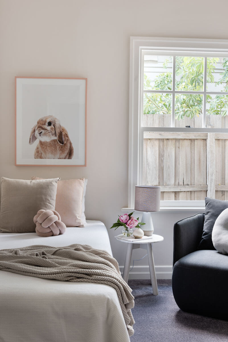 Kids bedroom styling with bunny artwork and soft pinks