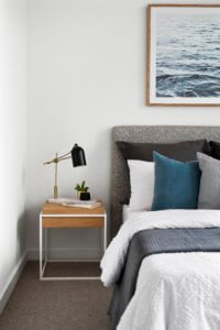 bedroom styling with grays and blues