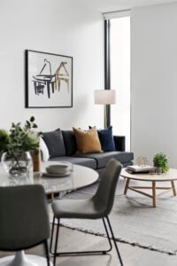 apartment lounge styling in gray blue tan and gold