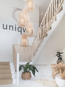 Rattan pendants above white staircase from Uniqwa, our favourite Brisbane furnisher